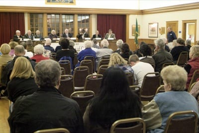 A near capacity crowd listens to council and school board candidates respond to issues affecting the community and school district. Candidates are (left to right) Town Council candidates Mayor Ron Lucas, Lowell G. Bier, Marion V. Smith, Connie Aboubaker and Steven L. Stovall and school district candidates Vincent Stewart, Michael Winkler and Kevin M. Callanan. Photo by Ed Kane, Freelance Graphics.