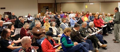 A large crowd filled the community meeting room of the Lakewood Library to hear Dick Blumenthal of Bellevue describe explorations of Puget Sound, particularly that of US Navy Lt. Charles Wilkes.