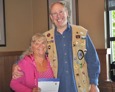 Lakewood First Lions Club President Eric Warn poses with Jan Rich after recognizing her 10 years as a member of the club at a recent meeting.