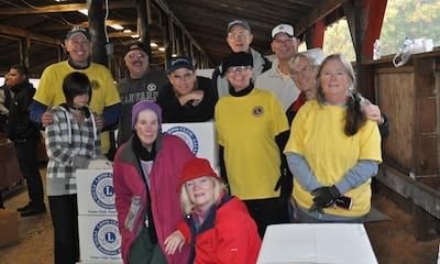 Lakewood First Lion Club members take a rest after packing apples to support children with diabetes. The club sold a record 77 of the 40 pound boxes this year. Hundreds of south Puget Sound area Lions clubs members converged on the fairgrounds in Lacey to box up thousands of pre-sold apples.