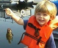 Author's grandson, Jacob Barr, then three-years-old, with his first whopper.