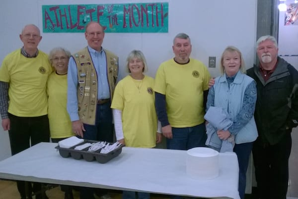 Standing left to right are Dr. Bob Allen, Kathie Theoe, Club President Eric Warn, Sally Saunders, Ed Formoso, and Club Vice President DeAnne Bennett and husband John.