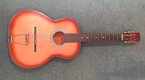Acoustic guitar. I own it. Someday I hope to play it.