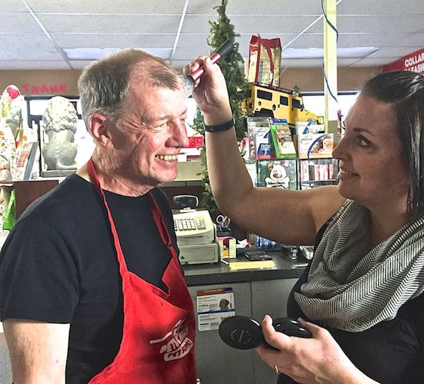 Make up artist, Rachael Wagoner, fixing my radio face for film while I am in full costume.