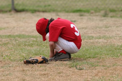 Discouraged youth baseball player